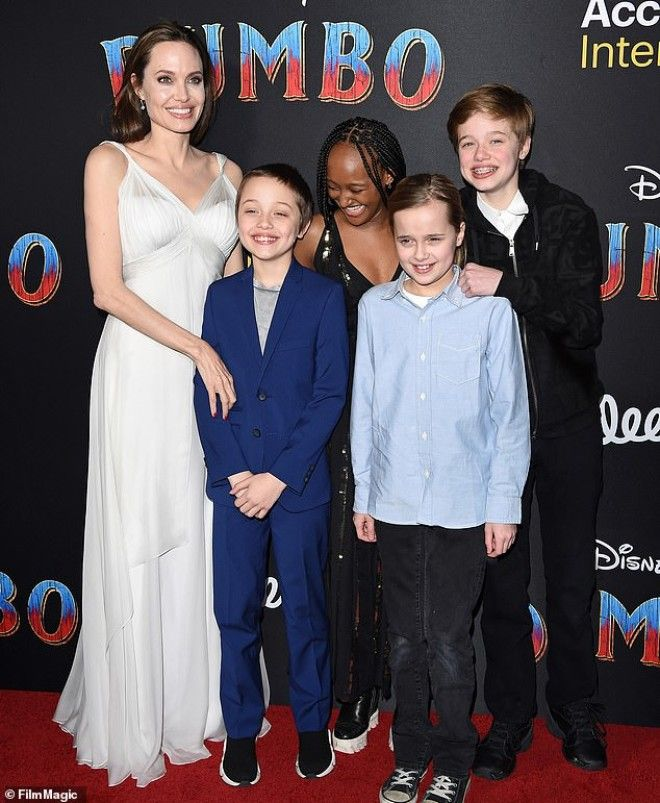 Showing support Angelina Jolie is a softie parents according to UsWeekly here she is seen at the Hollywood premiere of Dumbo with Vivienne and Knox as well as Shiloh and Zahara