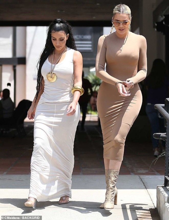 Sister act The reality star flaunted her famous curves as she was joined by her equally curvaceous sister Khloe